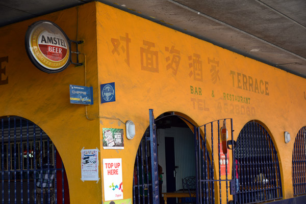 Terrace, a small Chinese bar & restaurant underneath the overpass leading to the Queen Juliana Bridge