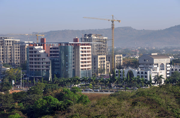 Newer construction to the north and west of the Abuja Hilton
