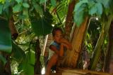 brother/17/ and sister at the end of Rob's driveway... in their banana tree play house