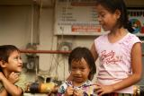 These three children are the ones i walked behind in a Pohnpei giant rainfall... and