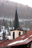 Church spire against the mountain