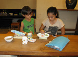 Wija and Sarinah Painting Pottery
