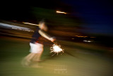 Sparklers and girl in motion