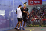 Mohamed El Shorbagy congratulates the younger Tarek Momen (white) for his win.