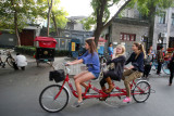 Tourists on a tricycle
