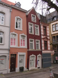 Colorful and leaning buildings by the square Katschof