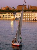 A felucca and Luxor Temple