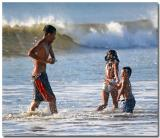Children Playing In The Surf