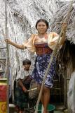 DSC01370 - Pretty Cuna woman helping extract sugar cane sap