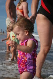 Line of baby girls in the water