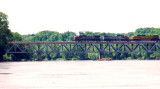 Just north of St. Francisville, a train emerges from the greenbelt
