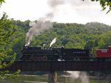 Black train, green hills