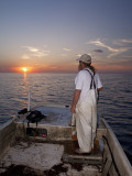 Commercial Fisherman Al Fariss Watches The Sun Set