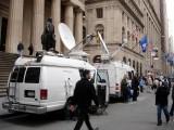 Reporters' vans at Wall Street