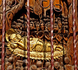 Reclining Buddha carved in wood