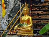 Buddha image with lotus buds