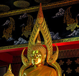 Buddha image, close up, with angels in the background