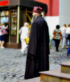 Monk taking up a collection