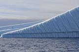 Parallel melt lines on an overturned berg