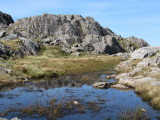 Rocks and a marshy pond on Bowfell