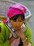 Bai woman in market place with carrying basket .jpg