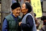 Two women discussing . . . .  Jishou City, China.