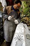 Carving a grave marker. Wuan Kou Town, Guizhou Province, China
