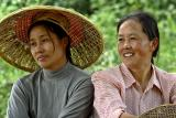 Two women relaxing in the shade on a hot and humid day. Ping Shan Po Village, Wuling Mts, Hunan, China