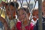 Schoolyard kids. Gao Shan, a high mountain village, Hunan Province, China.