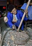 An elder grandfather working wood. #1