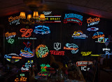 A wall of neon signs for sale, Wimberly, TX
