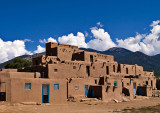 A multi story adobe residence used by tribal members.