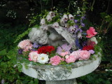 My old birdbath with some flowers
