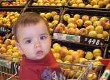 Charlie in the supermarket with peaches
