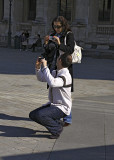 Taking Pictures in the Louvre Pyramid Courtyard.jpg