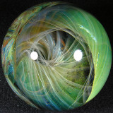 This is another of those fantastic Yaun marbles with the twisting silver fume over the gold!