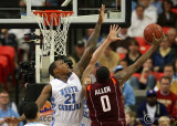 Tar Heels F Deon Thompson goes up to attempt to block the drive of Hokies F Jeff Allen