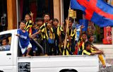 Kids celebrating victory of local football team