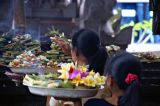 Balinese women performing traditional offerings