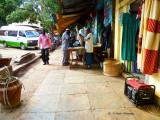 Work place on the side walks for many tailors.