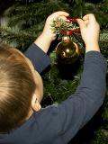 Oliver decorates Christmas tree