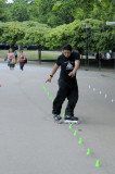 Young men practice their fancy inline skating moves