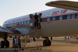 2010 - Carlos Gomez boarding the restored Eastern Air Lines DC-7B N836D for the flight to Oshkosh aviation stock photo #1257