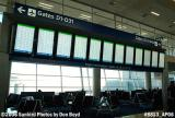 FIDS (Flight Information Display System) screens at Terminal D at Dallas Ft. Worth International Airport stock photo #8813