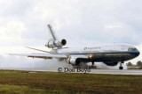 1980s - Eastern Airlines DC10-30 landing on wet runway at MIA