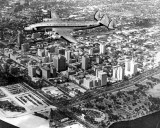 1950's - Eastern Air Lines Constellation over downtown Miami