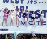 1963 - Linda Manson, Debbie Johns, Betty Warren, Irene, Gloria Wolfe and Linda High on a billboard