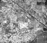 1938 - aerial view of south Hialeah, Miami Springs and Pan American Field (center) in Dade County, Florida