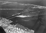 1950's - aerial view looking northeast over downtown Miami, Biscayne Bay and Miami Beach