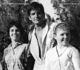 1961 - Sheila Poland, actor George Hamilton and Sheila's younger sister Linda Poland on the set of Angel Baby